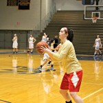Maggie Michael attempting a jumper | Tyler R. Tynes, Staff Photographer