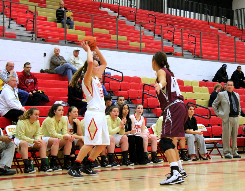 Kayla Feairheller lobs a pass cross-court during King's 70-50 home loss to No. 24 Eastern University on Wednesday night
