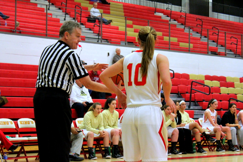 A referee chats with sophomore Kasey Seitz during King's 20 point loss to No. 24 Eastern Wednesday night at Scandlon Gymnasium | Staff Photographer Tyler R. Tynes